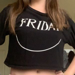 A black crop top that says Friday on the front